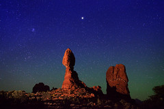 "Starry Night over Balanced Rock (IronRodArt - Royce Bair (""Star Shooter"")) Tags: park light sky lightpainting nature rock night dark painting stars star evening twilight sandstone shiny long exposure heaven glow shine nightscape time dusk infinity space deep arches twinkle astro sparkle formation galaxy national astrophotography planet astronomy archesnationalpark universe exploration cosmic starry cosmos balanced constellation distant nightscapes starrynight starlight geological balancedrock starrynightsky"