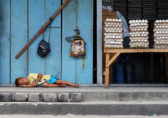 poor sleepy kid (ubo_pakes) Tags: poverty street city blue boy sleeping portrait stairs bag photography store kid nikon asia child market sleep candid philippines poor tired cebu eggs cebucity visayas ramos streetkid d60 ubo eggtray pakes mygearandme mygearandmepremium mygearandmebronze tpastreet