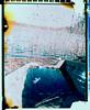 Old boat by the lake (negative) (mmartinsson) Tags: lake film polaroid boat spring scan negative april fujifilm sverige analogue bleached 2014 instantfilm polaroidee100special skånelän fujifp100c floaded peelapartfilm epsonperfectionv700