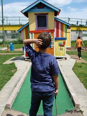 Perplexed  at Mini Golf (Patty Ballay) Tags: boy playing game boys sunshine sport spring play hobby minigolf puttputt miniaturegolf pattyballay