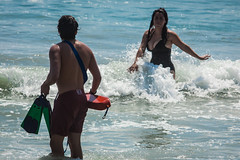 Oceanside LifeguardsG001A-IMG_7018 (EthnoScape) Tags: oceanside california cityofoceansidelifeguard lifeguards oceansidelifeguard oceansidelifeguards training trainer assistance drown drowning surf surfer surfboard lifesaver lifesavers rescue rescuer rescuetube rookie swim swimming swimmer swimmers athlete athletic health fitness youth boardshorts bikini wetsuit neoprene lycra rubber fiberglass polyurethane danger riptide ripcurrent red yellow baywatch fins swimfins tower lifeguardtower beach shore ocean water safety tourist touristseason jetski summer ethnoscape ethnoscapeimagery outdoor oceansidepier