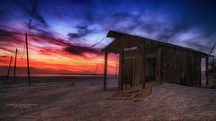 Sunset at Salton Sea (Linda Goodhue) Tags: california longexposure travel sunset sea sky building beach nature water clouds landscape nikon desert saltonsea d800 outbuilding nikond800 lindagoodhuephotography
