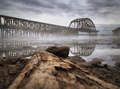 Rice's Point (Emily Bemily) Tags: bridge blue brown mist reflection ice wet water minnesota fog clouds fishing log day shoreline foggy floating mn duluth iphone ricespoint onmywayhomefromwork mobilephotography iphoneography iphone4s