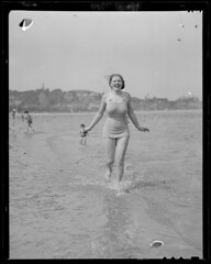 Wading woman finds the water at the beach a little cold (Boston Public Library) Tags: massachusetts beaches wading bathingbeauties lesliejones