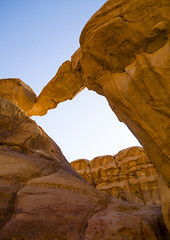 Rock Arch, Wadi Rum, Jordan (Eric Lafforgue) Tags: people nature rock vertical outdoors photography day wadirum middleeast nobody adventure jordan arabia geology exploration rockclimbing 107 clearsky jordanien jordanie jordania rockformation tranquilscene telawrence naturalarch  giordania traveldestinations rockarch  hashemitekingdomofjordan  jordani rdn lowangleview alurdun jordnia  yordania colourpicture  iordania   jordnsko