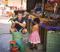 Making Friends, Oaxaca City, Mexico (elpedalero) Tags: travel viaje playing cute latinamerica americalatina frutas girl fruits birds animals bicycle america geotagged mexico cycling interesting funny child play friendship map traditional working parrot mercado exotic latin oaxaca latinoamerica tropical viagem littlegirl buckets fruitstand geotag selling streetfood parrots recent bicycletouring biketour loro centralamerica airelibre muchacha centroamerica adventurecycling exoticfood iberoamerica elsubmarino elpedalero pedalero