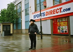 The deep sadness of the urban pirate (deepstoat) Tags: street london wet 35mm beard candid holloway contaxt3 piratehat handsinpockets kodakportra harrrhaarrmehearties