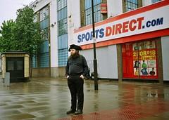 The deep sadness of the urban pirate (deepstoat) Tags: street london wet 35mm beard candid holloway contaxt3 piratehat handsinpockets kodakportra harrrhaarrmehearties