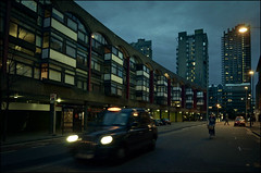Barbican Nights (Sven Loach) Tags: street uk windows england blur bus london architecture modern night lights evening spring nikon moody estate skyscrapers britain dusk cab taxi centre streetphotography pedestrian funky retro barbican stop 1970s clerkenwell brutalism towerblock brutalist lanes btonbrut cuclist d5100