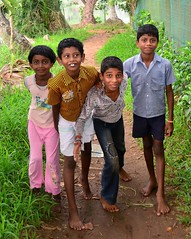 Bare-footed village kids of the backwaters, Kerala. (One more shot Rog) Tags: family india kids children village play smiles houseboat kerala together backwaters backwater alleppey