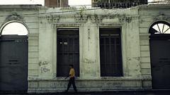 Walking Along (The PhotoMarksman) Tags: door old man wall vintage pared puerta paraguay viejo hombre asuncin omnia7