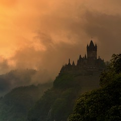The Epic of Reichsburg in Cochem (Bn) Tags: sunset sun sunlight mist castle history rain fog fairytale river germany point geotagged deutschland spring high topf50 day ray view magic dream battle charm vineyards valley alemania knight layers schloss viewpoint topf100 epic defense cochem topf200 impressive steep mosel rheinlandpfalz moselle reichsburg moezel 100faves 50faves 200faves 1000ad reichburg rijksburcht visipix keltenkeltiskceltiquegallic geo:lon=7168059 geo:lat=50147382