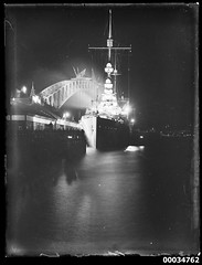 Night scene with HNLMS JAVA berthed at West Circular Quay wharf, October 1930