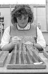 87061017.jpg (Martin Jenkinson Images) Tags: lighting blue people blackandwhite woman white black industry lamp monochrome bulb female work blackwhite track industrial unitedkingdom 1987 line 80s production worker manual collar thorn 1980s making 87 filament assembly greyscale bluecollar makers manufacture gbr manufacturing productionline thornlighting