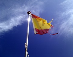 The Tatters of a Spanish Flag Fly (The Puzzler) Tags: mediterranean flag bluesky spanish ibiza shredded tattered rojigualda banderadeespaa