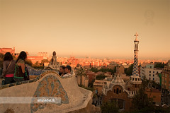 Park Guell at sunset (arturii!) Tags: barcelona city light sunset sea sky people color sol beauty set architecture wow bench amazing nice europa europe cityscape view superb awesome hill capital great wave tourist catalonia architect gaudi stunning vista parc ona impressive parkguell modernisme gettyimages skyine oriel tur eixample trencadis interestin canoneos400d arturii arturdebattk mediterrenan