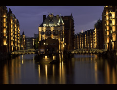 Speicherstadt / Hamburg / Germany (zilverbat.) Tags: city nightphotography travel urban history architecture germany de deutschland 50mm lights abend wasser nightimages cityscape nightlights dof nightshot nacht centre hamburg bridges himmel wideangle storage unesco le german architektur bluehour dslr hafen alster altstadt canondslr spiegelung centrum speicherstadt cityatnight hotspot architectuur duitsland worldheritage donker lightroom nachtfotografie nightexposure hansestadt reizen binnenalster brucke 1883 duits authentiek spiegeling wasserschloss freihafen bruggen citytrip dokken lenight abschlussfahrt zollkanal unescoheritage groothoek pakhuizen denkmalschutz nachtaufnahmen hanzestad hansestadthamburg oldwarehouses canon7d zilverbat lagerhauscomplex