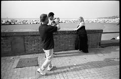 (Fashion Week Revisited) (Robbie McIntosh) Tags: leicamp leica mp rangefinder streetphotography 35mm film pellicola analog analogue negative leicam analogico blackandwhite bw biancoenero bn monochrome argentique dyi selfdeveloped filmisnotdead autaut candid strangers leicaelmarit28mmf28iii elmarit28mmf28iii elmarit 28mm arsimagofd arsimagofddeveloper arsimagofd139 seaside mappatellabeach rocks lidomappatella kodaktmax100 kodak tmax man woman tattoo poser