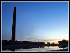 Stewartby Brickworks at Dawn (Jon 89) Tags: old morning blue light summer chimney england sky urban sun black reflection building brick london tower abandoned industry water rain night sunrise buildings reflections dark walking landscape puddle bedford photography dawn daylight early town photo site cool soft closed industrial day village view britain beds near walk exploring united bricks great central bedfordshire kingdom ground visit scene shades location panoramic company shade depot disused brickworks rise furnace kiln derelict hanson urbex 2011 stewartby stewartbybrickworks londonbrickcompany