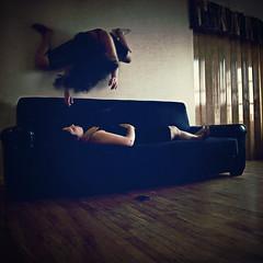 Haunted Dreams (Sandra Ayala Photography) Tags: sleeping woman selfportrait wall dark scary darkness sofa haunting disturbing