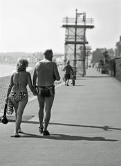 Beach Bum's (Paula Fry) Tags: street man beach sunshine lady canon bag mono couple candid sunny bikini esplanade dorset trunk bums 450 weymouth speedos jurassiccoast 112picturesin2012 112in2012