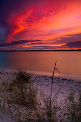 Mantanzas Sunset (John Cothron) Tags: ocean sunset sky cloud sun color beach nature water creek 35mm canon river landscape spring twilight stream florida dusk scenic flowing atlanticocean staugustine saltwater freshwater sunshinestate stjohnscounty mantanzasriver johncothron 5dmkii cothronphotography mantanzasinlet 2jtrip20121 johncothron img09025120405 fortmantanzasnationalmonument