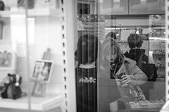 being a customer (Tafelzwerk) Tags: street people white black store nikon menschen laden pay buy schwarz geschft weis strase bezahlen d7000 tafelzwerk