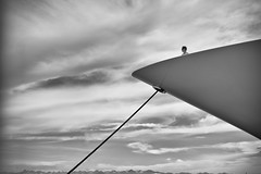 big toys (Thomas Leth-Olsen) Tags: antibes locations portvauban bw bigtoys billionaires boat clouds minimal money person rich view