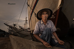 At the Docks (Ragstatic) Tags: old light sea sky man heritage port vintage indonesia dock ship culture ragstatic