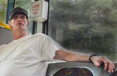 IN EMERGENCY BREAK COVER (sadler0) Tags: street portrait people man bus men texas homeless riders poorpeople busriders