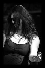 Dancing into the Light (Poocher7) Tags: street shadow portrait blackandwhite woman sun ontario canada monochrome beautiful outdoors dance pretty dancing expression bellydancer dancer kitchener belly bellydance lovely prettygirl streetparty darkhair fingercymbals darkandlight shinyhair hohnerporchparty blackharemdress