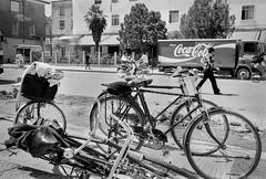 Skoder, Albania 1998 (Alberto Prez Puyal) Tags: china leica bike cola coke communism alberto plus hp5 1998 capitalism albania coca m2 ilford bycicle perez dictatorship enver hoxa skodra skoder puyal