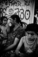 The Love of a Gypsy Mother (stimpsonjake) Tags: city family blackandwhite bw love monochrome children mom skull candid joy mother streetphotography highcontrast happiness romania gypsy bucharest 185mm nikoncoolpixa