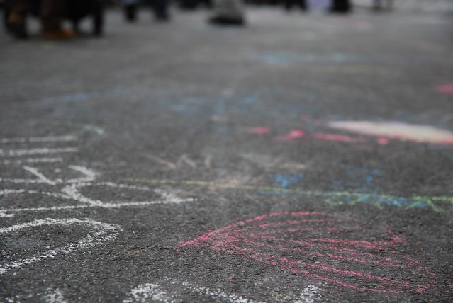Kids chalk drawings on Little Lonsdale Street - close