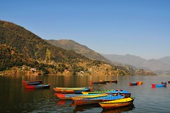Boats (Melinda ^..^) Tags: nepal mountain lake snow color reflection nature water boat colorful ripple mel melinda pokhara fewa annapurna himalayas  fewalake chanmelmel