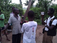 "The Cheerful Hearts team and media man from TVAfrica interviews Unit committee head of the village  concerning their source of drinking water • <a style=""font-size:0.8em;"" href=""http://www.flickr.com/photos/48668870@N02/7097179469/"" target=""_blank"">View on Flickr</a>"
