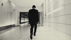 headphones, black suit, and converging lines (explore) (stephane (montreal)) Tags: city people urban music white man black building modern photography noir montreal interior business inside et blanc ville headphone musique stephane 2012 abstact paquet