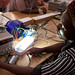 Gertrude from Malawi tests one of her solar lights