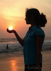 Aroon Kalandy    Sun.............. (aroon_kalandy) Tags: sunset sky sun beach girl mobile holding calicut aroonkalandy nokiae7