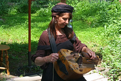 The Hurdy Gurdy Player (oldsouthvideo) Tags: costumes castle festival spring tn tennessee pirates may queen fairy armor taylor knight faire troll swift renaissance ik jousting regal triune tapestry 2012 fairie gwynn arrington