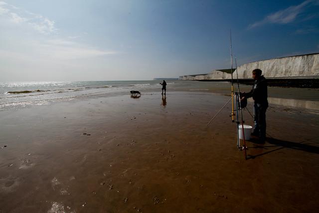 Fisherman at Birling Gap looking towards the Seven Sisters