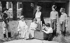 The Play (theirhistory) Tags: children girls boys basket hat trousers grass wellies jumper primary junior uk gb class form school pupils students education