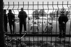 Watching the game. (Originalni Digitalni) Tags: people blackandwhite black men art field bicycle standing canon fence photography football raw sitting outdoor soccer watching players dslr lightroom fotografija umjetnost 60d slavonskibrod originalnidigitalni tomislavlai tomislavlai