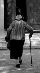 A church goer (Aga Dzicio) Tags: church churchgoer child old cane oldage door past passingtime oldwoman woman elderly staruszka