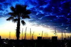 Puerto. Punta del Moral (Huelva) (Angela Garcia C) Tags: puerto paisaje urbano urbanismo turismo infraestructura farola atardecer nubes vegetacin embarcaciones puntadelmoral equipamiento huelva hidrologa geografaurbana