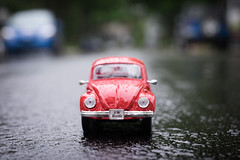 the beetle (le cabri) Tags: street old red reflection cute rain fashion vw germany volkswagen toy outdoors europe rainyday beetle retro replica german transportation hippie volks iconic toycar frontview 1960 germanculture 19601969 landvehicle retrostyled
