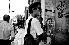 We Were Friends When We Were Young (stimpsonjake) Tags: city friends students hat university cigarette candid streetphotography romania bucharest youngwoman youngman peaking 185mm nikoncoolpixa
