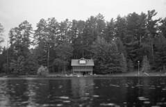 Classic Cottage (yesimahuman) Tags: vacation lake film wisconsin 35mm cabin minolta kodak trix 400 filmphotography srt100 cabinporn