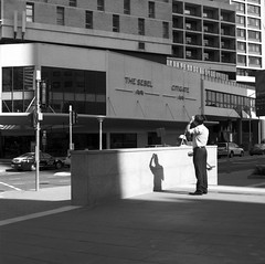 Brisbane CBD (Geoff A Roberts) Tags: street old urban bw man 120 zeiss landscape photography rebel holding head geoff australia brisbane hasselblad carl queensland medium format cbd roberts rodinal ilford fp4 planar 80mm 501cm cfe adox adonal sebel citigate