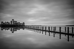 Mirror (Robgreen13) Tags: uk longexposure shadow bw seascape reflection water clouds canon fence buildings landscape eos chains waterfront shoreline somerset coastal railings westonsupermare seapool 650d 10stopper iplymouth yahoo:yourpictures=coastal